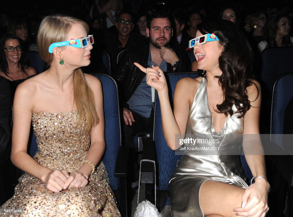Taylor Swift and Selena Gomez in the audience at the 2011 American Music Awards at the Nokia Theatre L.A. LIVE on November 20, 2011 in Los Angeles, California.