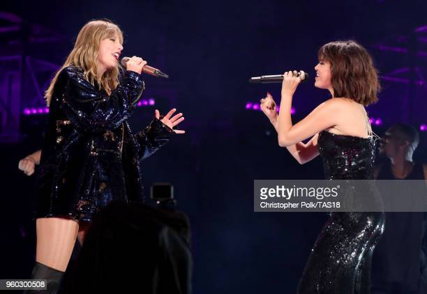 Taylor Swift and Selena Gomez perform onstage during the Taylor Swift reputation Stadium Tour at the Rose Bowl on May 19 2018 in Pasadena California