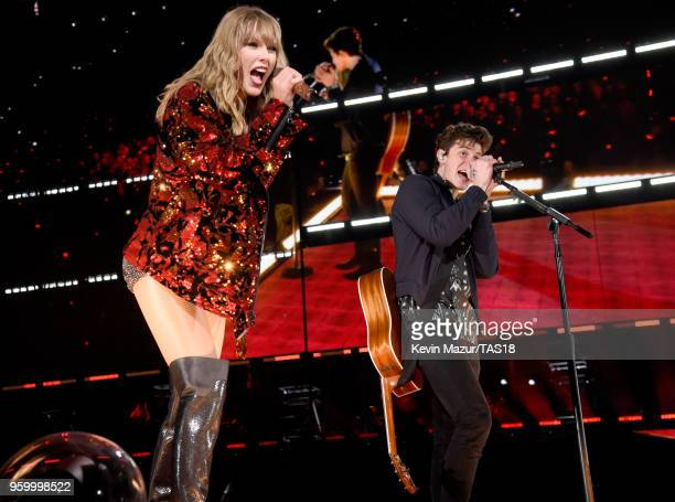 Taylor Swift and Shawn Mendes perform onstage during the Taylor Swift reputation Stadium Tour at the Rose Bowl on May 18 2018 in Pasadena California