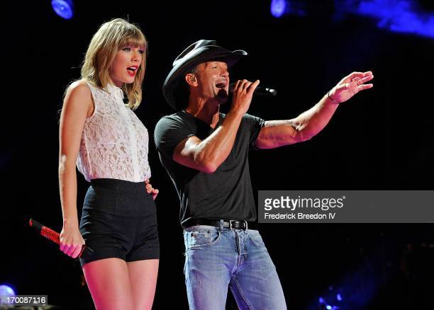 Taylor Swift and Tim McGraw perform at LP Field during the 2013 CMA Music Festival on June 6, 2013 in Nashville, Tennessee.