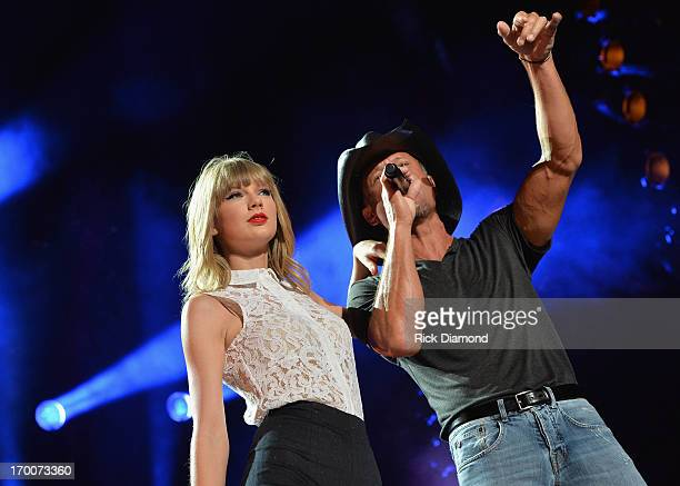 Taylor Swift and Tim McGraw perform during the 2013 CMA Music Festival on June 6 2013 in Nashville Tennessee