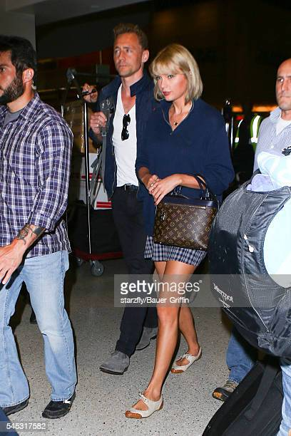 Taylor Swift and Tom Hiddleston are seen at LAX on July 06 2016 in Los Angeles California