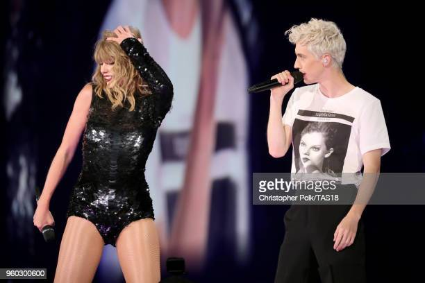 Taylor Swift and Troye Sivan perform onstage during the Taylor Swift reputation Stadium Tour at the Rose Bowl on May 19 2018 in Pasadena California