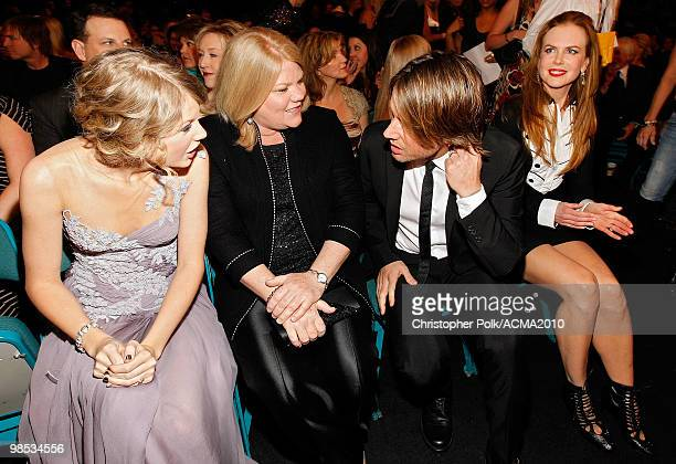 Taylor Swift Andrea Swift Nicole Kidman and Keith Urban talk in the audience at the 45th Annual Academy of Country Music Awards at the MGM Grand...