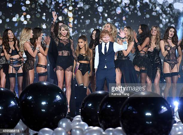 Taylor Swift Ariana Grande and Ed Sheeran pose with the models on the runway at the annual Victoria's Secret fashion show at Earls Court on December...