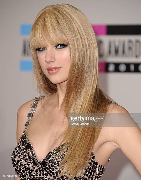 Taylor Swift arrives at the 2010 American Music Awards held at Nokia Theatre LA Live on November 21 2010 in Los Angeles California