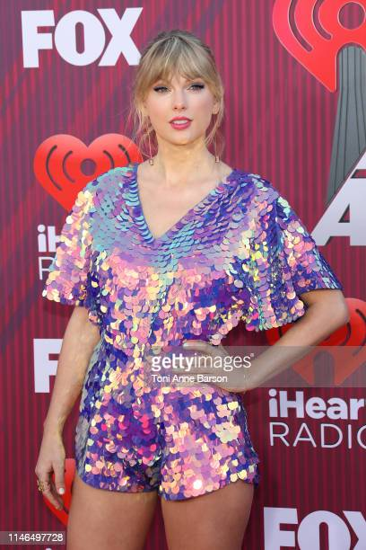 Taylor Swift arrives at the 2019 iHeartRadio Music Awards which broadcasted live on FOX at Microsoft Theater on March 14 2019 in Los Angeles...