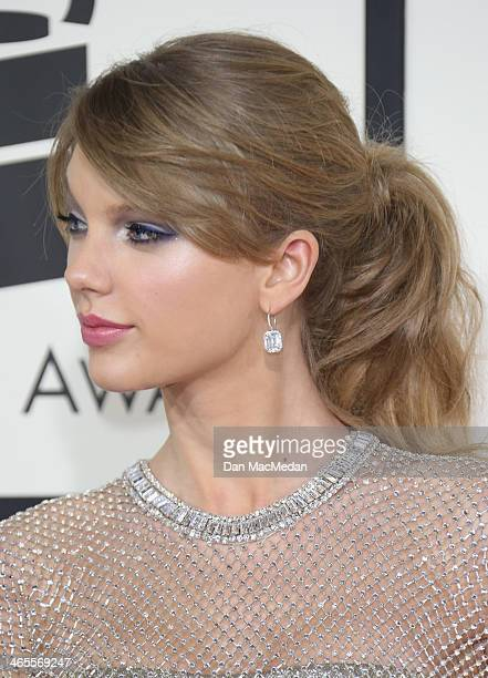 Taylor Swift arrives at the 56th Annual GRAMMY Awards at Staples Center on January 26 2014 in Los Angeles California