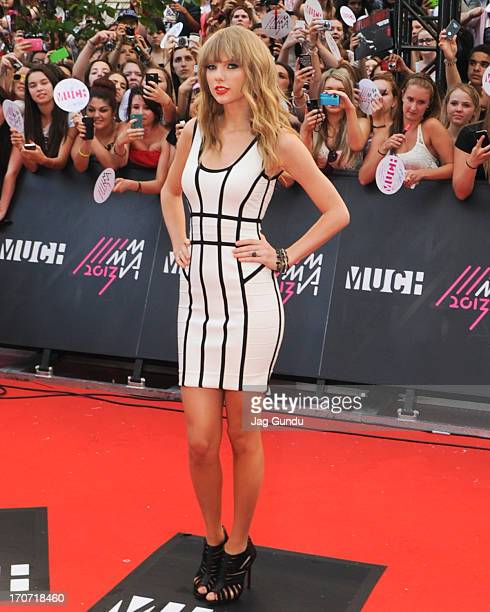 Taylor Swift arrives on the red carpet at the 2013 MuchMusic Video Awards at Bell Media Headquarters on June 16 2013 in Toronto Canada