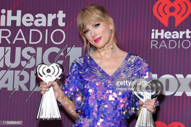 Taylor Swift attends 2019 iHeartRadio Music Awards press room during the 2019 iHeartRadio Music Awards which broadcasted live on FOX at Microsoft...