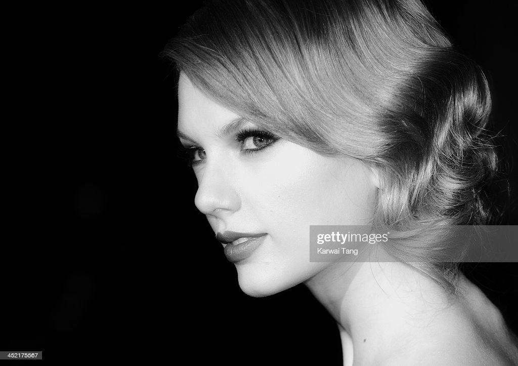 Taylor Swift attends the Winter Whites Gala in aid of Centrepoint at Kensington Palace on November 26, 2013 in London, England.