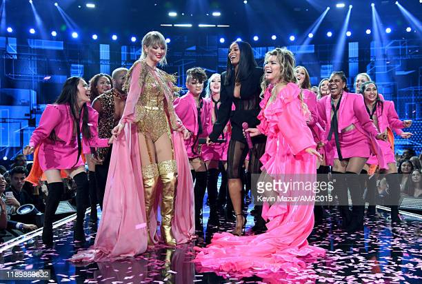 Taylor Swift Ciara and Shania Twain perform onstage during the 2019 American Music Awards at Microsoft Theater on November 24 2019 in Los Angeles...