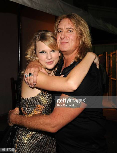 NASHVILLE TN OCTOBER 06 Taylor Swift Def Leppard's Joe Elliott wish each other luck before the taping of CMT CROSSROADS in Nashville on Oct 6 2008...