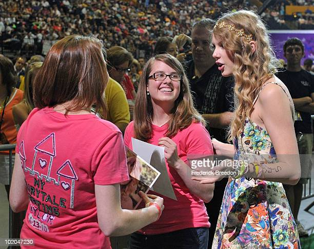 Christian cota pictures and photos getty images taylor swift greets a few of the thousands of fans who attended the taylor swift m4hsunfo