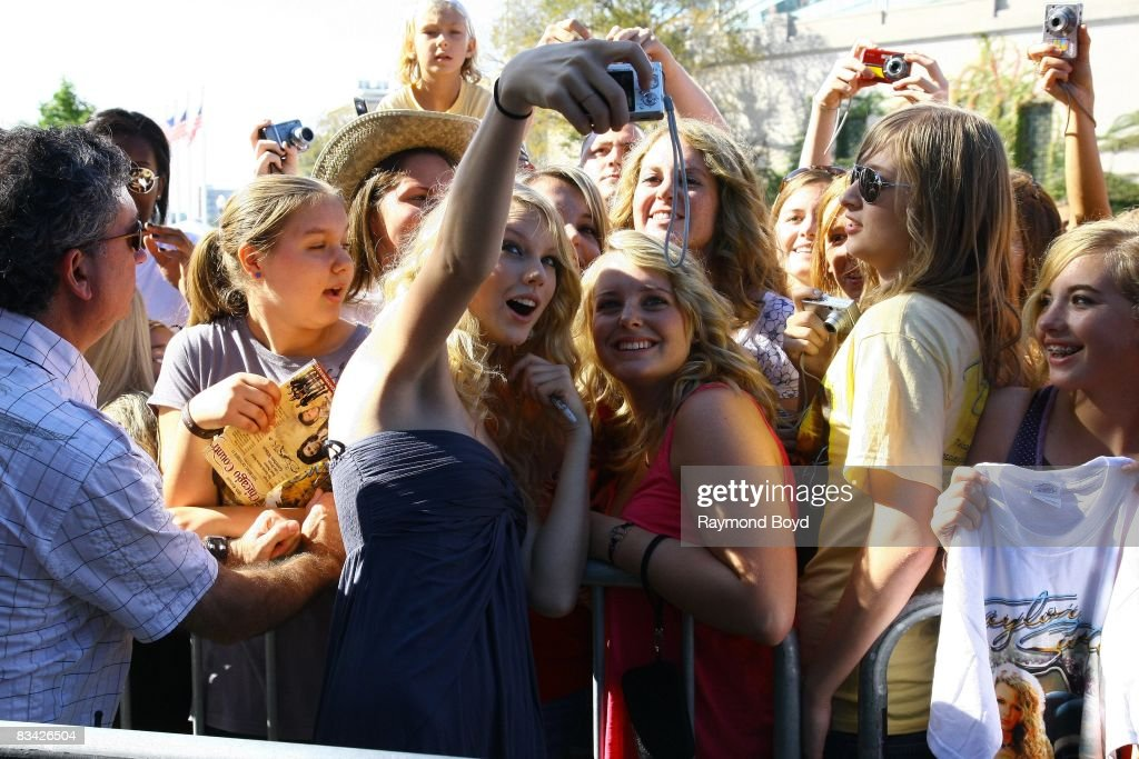 Taylor Swift greets fans before her performance during the 18th annual Chicago Country Music Festival at Soldier Field Parkland in Chicago, Illinois on October 12, 2008.