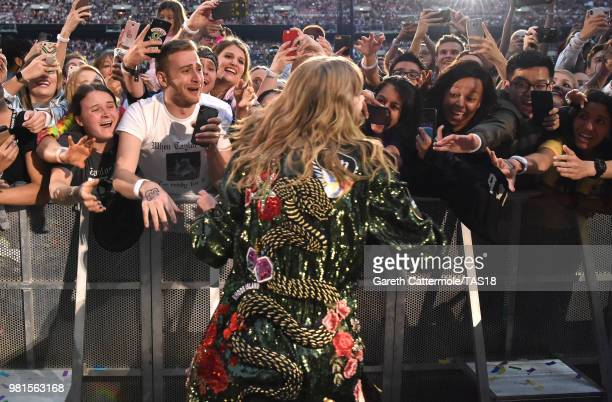 Taylor Swift greets fans during the reputation Stadium Tour at Wembley Stadium on June 22 2018 in London England