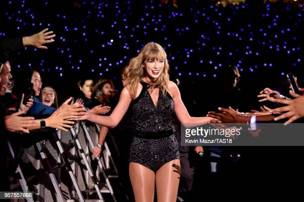 Taylor Swift highfives fans during Taylor Swift reputation Stadium Tour at Levi's Stadium on May 11 2018 in Santa Clara California