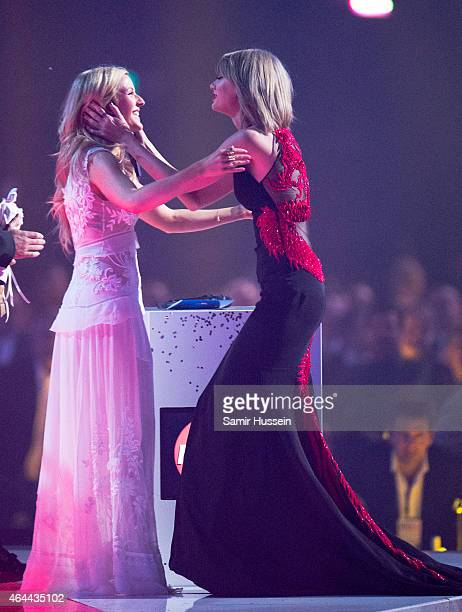 Taylor Swift hugs Ellie Goulding at the BRIT Awards 2015 at The O2 Arena on February 25, 2015 in London, United Kingdom