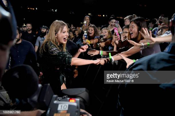 Taylor Swift interacts with her fans during the Taylor Swift reputation Stadium Tour at Gillette Stadium on July 26 2018 in Foxborough Massachusetts