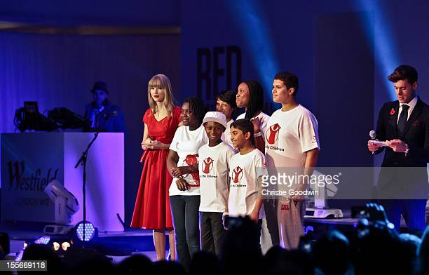 Taylor Swift is joined by young ambassadors of the Save The Children charity to switch on the Christmas lights at Westfield on November 6 2012 in...