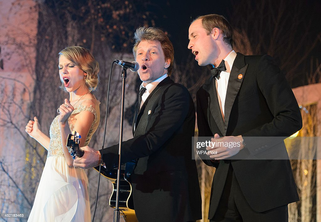 Taylor Swift, Jon Bon Jovi and Prince William, Duke of Cambridge sing on stage at the Centrepoint Gala Dinner at Kensington Palace on November 26, 2013 in London, England.