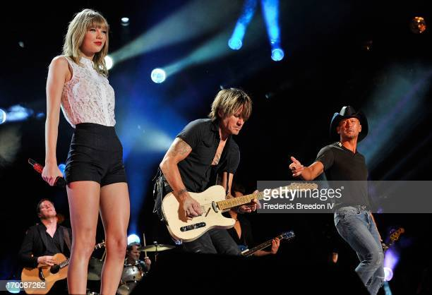Taylor Swift Keith Urban and Tim McGraw perform at LP Field during the 2013 CMA Music Festival on June 6 2013 in Nashville Tennessee