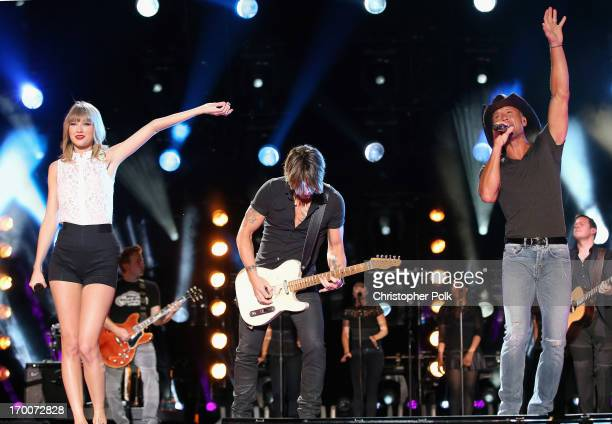 Taylor Swift Keith Urban and Tim McGraw perform during the 2013 CMA Music Festival on June 6 2013 in Nashville Tennessee