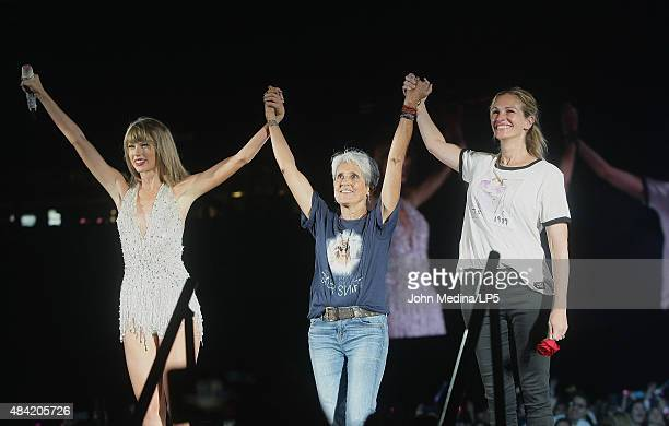 Taylor Swift musician Joan Beaz and actress Julia Roberts take a bow on stage during Swift's 'The 1989 World Tour' at Levi's Stadium on August 15...
