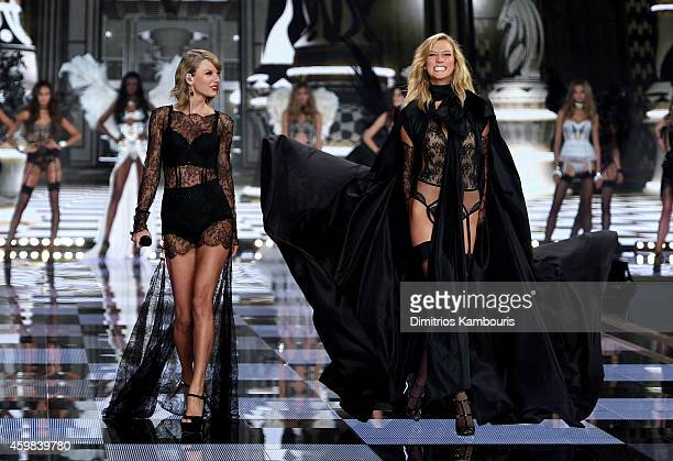 Taylor Swift performs as model Karlie Kloss walks the runway during the 2014 Victoria's Secret Fashion Show at Earl's Court Exhibition Centre on...