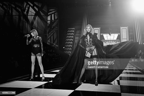 Taylor Swift performs as Victoria's Secret model Karlie Kloss walks the runway during the 2014 Victoria's Secret Fashion Show at Earl's Court...