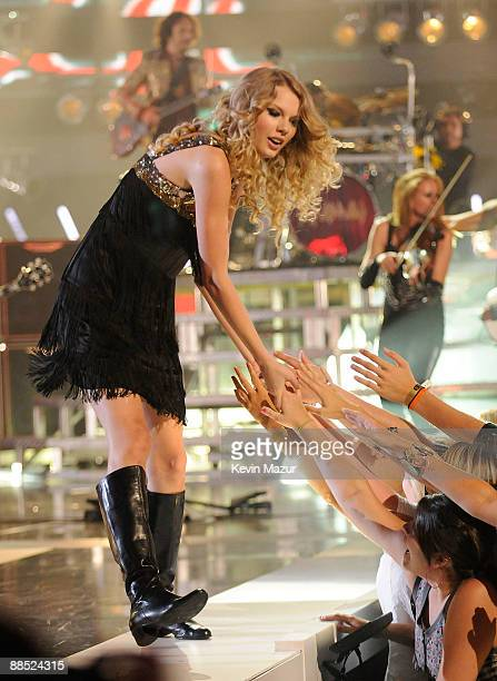 Taylor Swift performs on stage at the 2009 CMT Music Awards at the Sommet Center on June 16 2009 in Nashville Tennessee