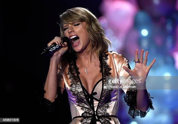 Taylor Swift performs on the runway at the annual Victoria's Secret fashion show at Earls Court on December 2 2014 in London England