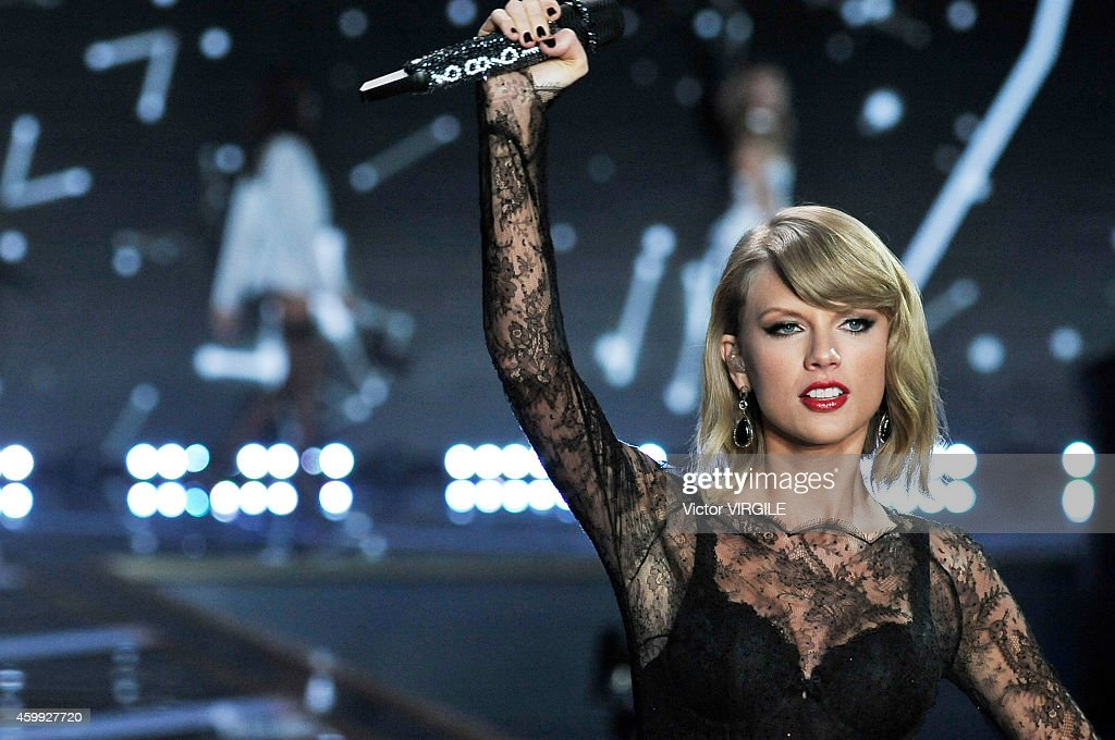 Taylor Swift performs on the runway during the 2014 Victoria's Secret Fashion Show at Earl's Court exhibition centre on December 2, 2014 in London, England.