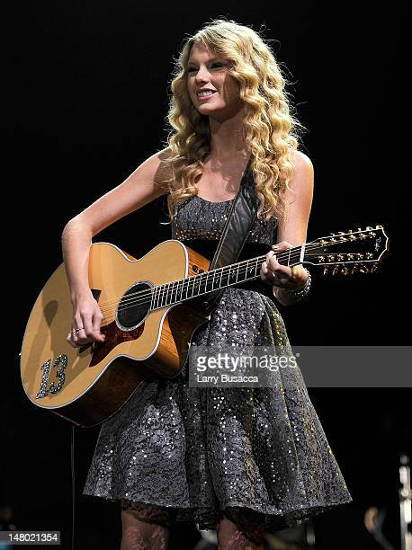 Taylor Swift performs onstage at the 'We're All For The Hall' benefit concert for the Country Music Hall of Fame at the Sommet Center on October 13...