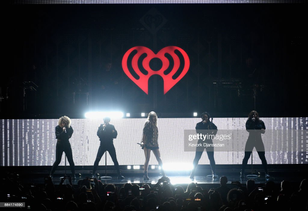 Taylor Swift (C) performs onstage during 102.7 KIIS FM's Jingle Ball 2017 presented by Capital One at The Forum on December 1, 2017 in Inglewood, California.