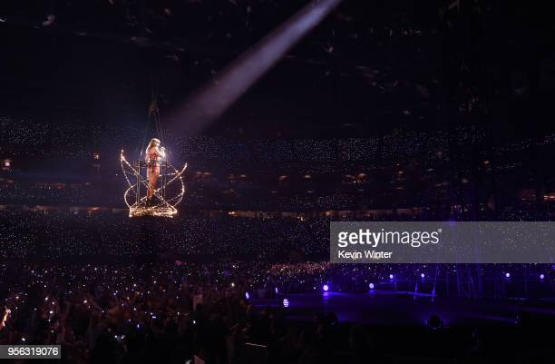Taylor Swift performs onstage during opening night of her 2018 Reputation Stadium Tour at University of Phoenix Stadium on May 8 2018 in Glendale...