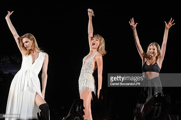 Taylor Swift performs with Andreja Pejic and Lily Donaldson during The 1989 Tour at Soldier Field on July 19 2015 in Chicago Illinois