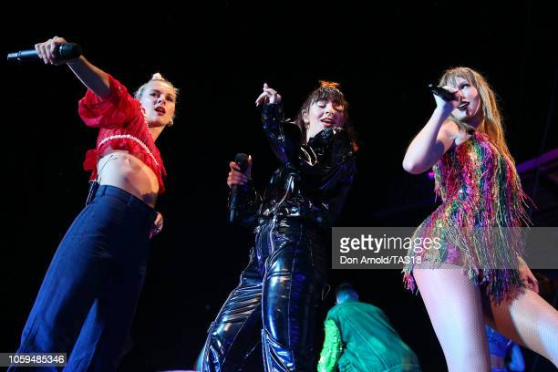 Taylor Swift performs with Georgia Nott of Broods and Charli XCX at Mt Smart Stadium on November 9 2018 in Auckland New Zealand