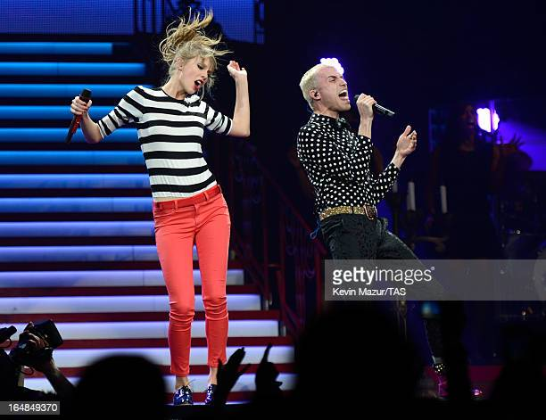 Taylor Swift performs with Tyler Glenn of Neon Trees on stage at Prudential Center on March 28 2013 in Newark New Jersey Seventime GRAMMY winner...