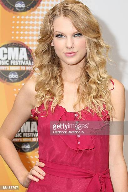 Taylor Swift poses for photographs at the 2009 CMA Music Festival at LP Field on June 14, 2009 in Nashville, Tennessee.