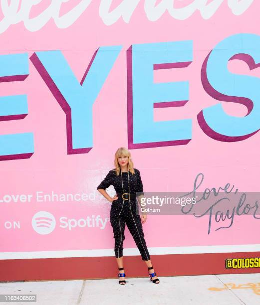 Taylor Swift poses in front of a mural introducing her latest album Lover on August 23 2019 in in the Brooklyn borough of New York City