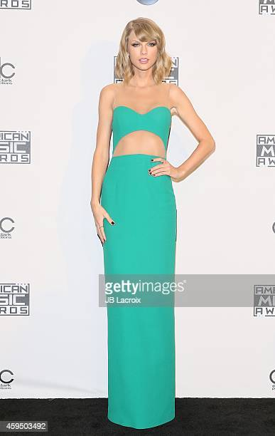 Taylor Swift poses in the press room at the 2014 American Music Awards at Nokia Theatre LA Live on November 23 2014 in Los Angeles California
