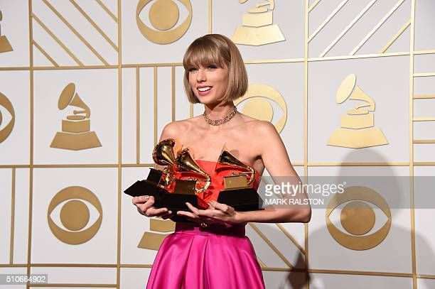Taylor Swift poses in the press room at the The 58th GRAMMY Awards at Staples Center on February 15 2016 in Los Angeles California AFP PHOTO/MARK...