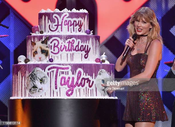 Taylor Swift poses with a giant birthday cake onstage during iHeartRadio's Z100 Jingle Ball 2019 Presented By Capital One on December 13, 2019 in New...