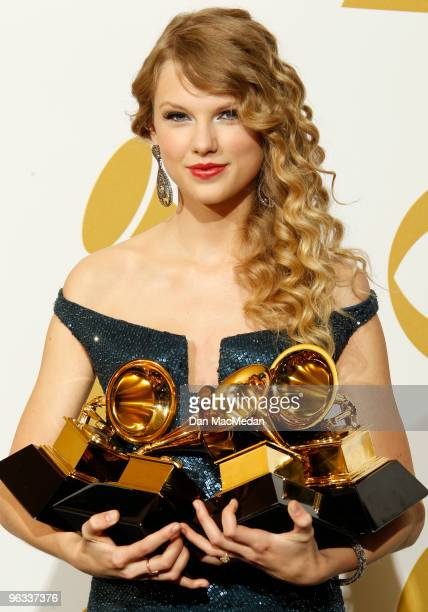 Taylor Swift poses with her awards in the press room at the 52nd Annual GRAMMY Awards held at Staples Center on January 31 2010 in Los Angeles...