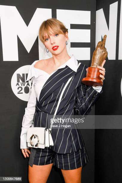 Taylor Swift poses with the Best Solo Act In The World Award in the winner room at the NME Awards 2020 at O2 Academy Brixton on February 12 2020 in...