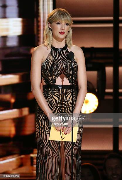 Taylor Swift presents an award onstage at the 50th annual CMA Awards at the Bridgestone Arena on November 2 2016 in Nashville Tennessee