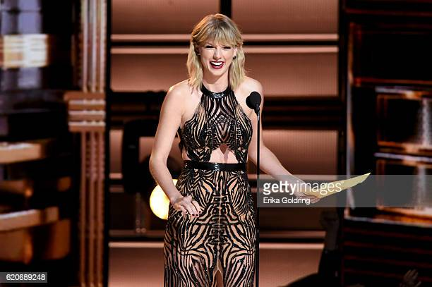 Taylor Swift presents award onstage at the 50th annual CMA Awards at the Bridgestone Arena on November 2 2016 in Nashville Tennessee