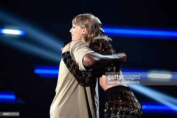 Taylor Swift presents award to Kanye West onstage during the 2015 MTV Video Music Awards at Microsoft Theater on August 30 2015 in Los Angeles...