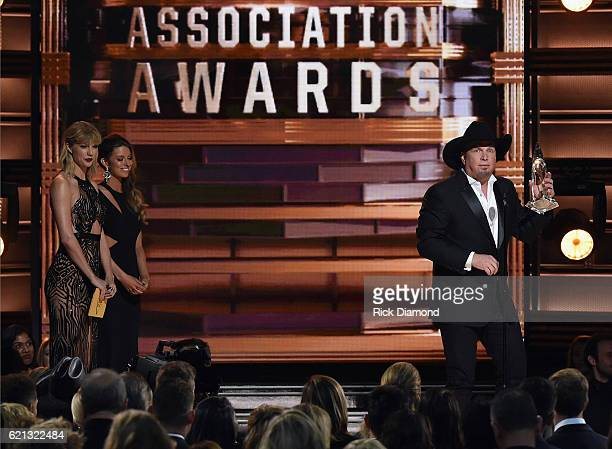 Taylor Swift presents Garth Brooks The Entertainer of the Year award onstage at the 50th annual CMA Awards at the Bridgestone Arena on November 2...